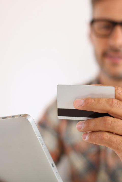 Man holding his credit card, ready to purchasing some cannabis